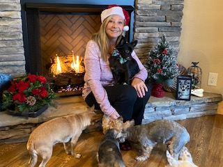 Jackie Hamby with her new rescue and her pack.